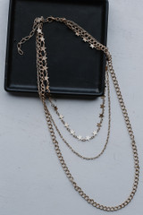 Flat Lay of a Gold Star Layered Necklace