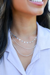 Silver - Model wearing a Star Layered Necklace