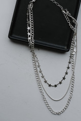 Silver - Flat Lay of a Star Layered Necklace
