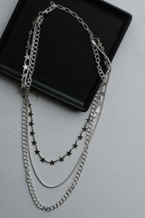 Flat Lay of a Star Layered Necklace in Silver