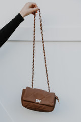 Mocha - Model holding a Quilted Crossbody Bag