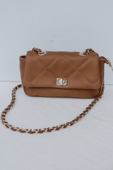 Mocha - Flat Lay of a Quilted Crossbody Bag