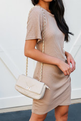 Ivory - Dress Up model holding a Quilted Crossbody Bag