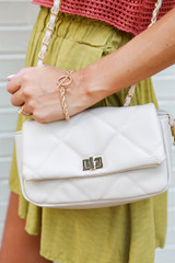 Close Up of a Quilted Crossbody Bag in Ivory