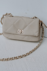 Flat Lay of a Quilted Crossbody Bag in Ivory