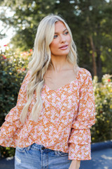 Model wearing a Floral Blouse