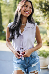 Model wearing a Tie-Front Cropped Blouse with denim shorts