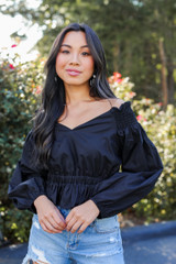 Model wearing an Off-The-Shoulder Blouse