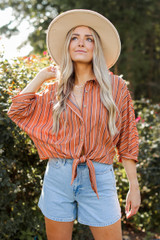 Model wearing a Striped Button Up Blouse