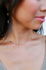 Model wearing a Gold Pearl Necklace