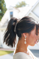 Model wearing a Claw Hair Clip in Clear