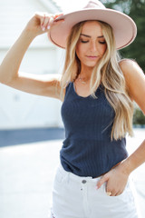 Navy - Model wearing a Knit Tank with a wide brim hat