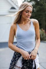 Light Blue - Model wearing a Knit Tank with a flannel and white shorts