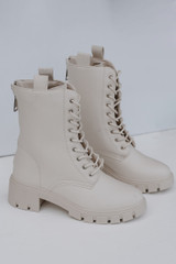 Ivory - Flat Lay of Combat Boots