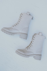 Flat Lay of Combat Boots in Ivory