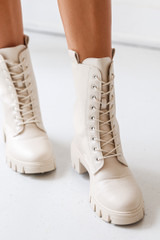 Model wearing Combat Boots in Ivory