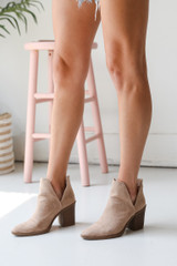 Model wearing Ankle Booties in Taupe