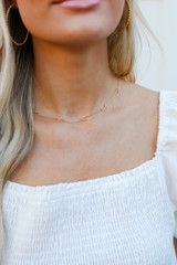Model wearing a Gold Star + Moon Necklace
