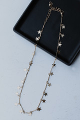 Flat Lay of a Gold Star Necklace