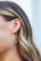 Model wearing Gold Textured Small Hoops
