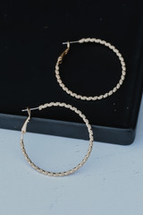 Flat Lay of Gold Textured Small Hoops