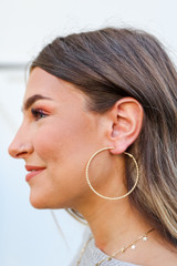 Model wearing Gold Textured Large Hoops