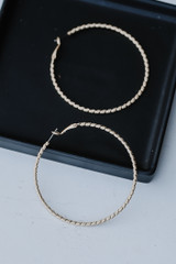 Flat Lay of Gold Textured Large Hoops