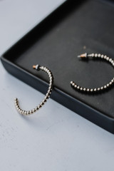 Flat Lay of Gold Ball Hoops