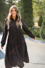 Dress Up model wearing a Tiered Maxi Dress in Black