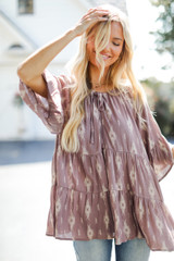 Dress Up model wearing a Tiered Blouse