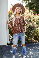 Model wearing a Floral Babydoll Blouse