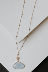 Flat Lay of a Gold Stone Necklace