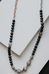 Black - Flat Lay of a Beaded Necklace