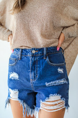Model wearing Distressed Mom Shorts