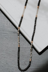 Flat Lay of a Black Beaded Necklace