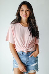 Blush - Model wearing an Everyday Tee with denim shorts