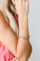 Model wearing a Gold Layered Smiley Face Bracelet