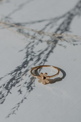 Flat Lay of a Gold Flower Ring