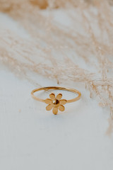 Close Up of a Gold Flower Ring