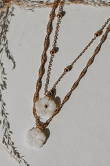 Close Up of a Gold Flower Layered Necklace