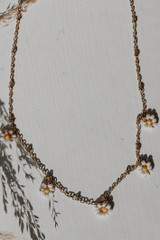 Flat Lay of a Gold Beaded Flower Necklace