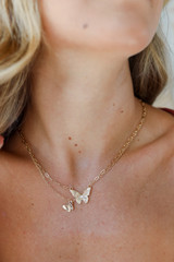 Dress Up model wearing a Gold Layered Butterfly Necklace