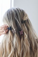 Olive - Model wearing Butterfly Claw Hair Clips