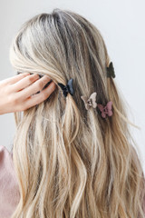 Olive - Dress up model wearing Butterfly Claw Hair Clips