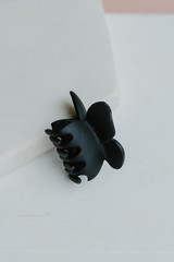 Black - Butterfly Claw Hair Clip on a white background