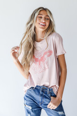 Model wearing the Rock And Roll Graphic Tee