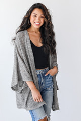 Olive - Model wearing a Loose Knit Cardigan with jeans