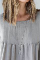 Model wearing a Gold Gemstone Necklace