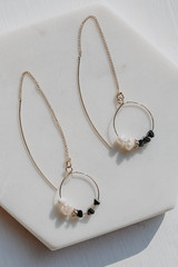 Flat Lay of Statement Threader Earrings