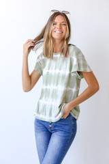 Olive - Model wearing a Tie-Dye Tee with jeans